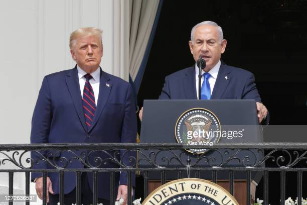 Prime Minister of Israel Benjamin Netanyahu speaks as U.S. President Donald Trump looks on during the signing ceremony of the Abraham Accords on the...