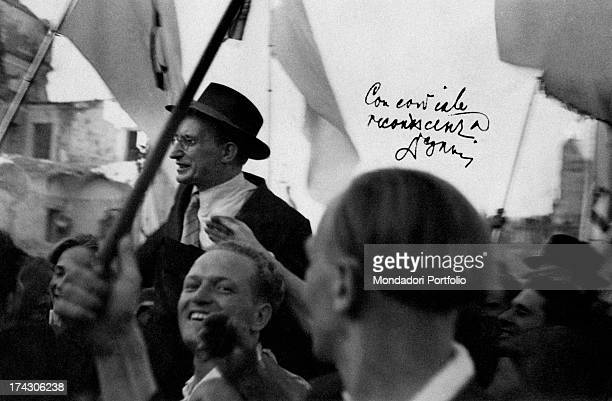 Prime Minister of Italy Alcide De Gasperi is carried shoulderhigh in triumph by a group of Christian democrats The autographed photograph has been...