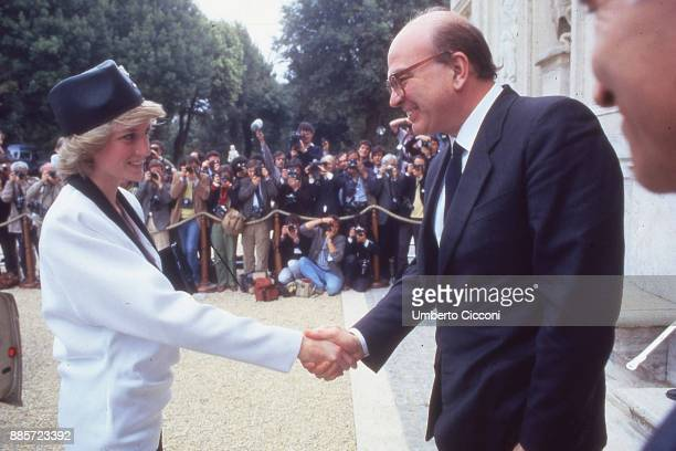 Prime Minister of Italy Bettino Craxi shakes the hand of Princess Diana during a welcome party for the royalty in Villa Doria Pamphili Rome 1985