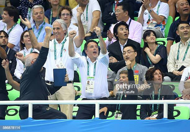 Prime Minister of Italy Matteo Renzi jumps between CONI President Giovanni Malago his son and his wife Agnese Landini to celebrate the bronze medal...