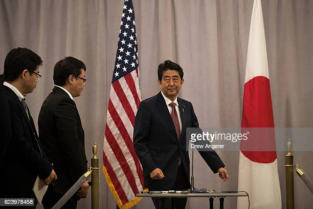 Prime Minister of Japan Shinzo Abe arrives to speak to reporters following a meeting with Presidentelect Donald Trump November 17 2016 in New York...