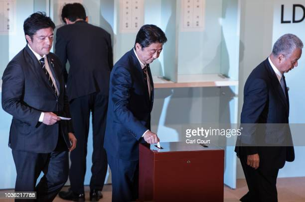 Prime Minister of Japan Shinzo Abe casts his ballot during a leadership election for the ruling Liberal Democratic Party on September 20 2018 in...