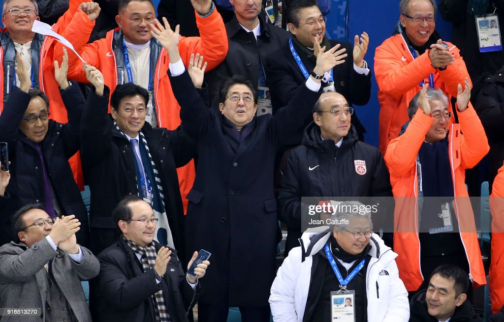 Prime Minister of Japan Shinzo Abe celebrates the goal of Japan during the women's ice hockey preliminary match between Japan and Sweden during the 2018 Winter Olympic Games at Kwandong Hockey Centre on February 10, 2018 in Gangneung, Pyeongchang, South Korea.