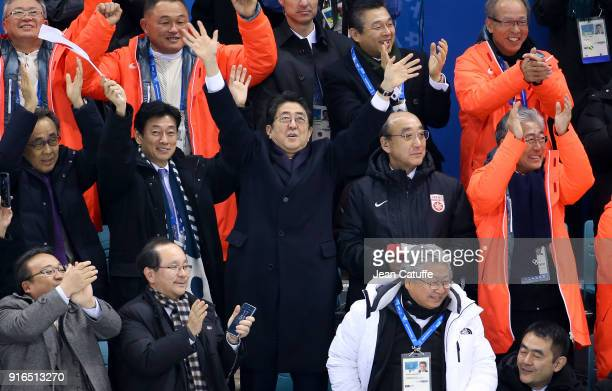 Prime Minister of Japan Shinzo Abe celebrates the goal of Japan during the women's ice hockey preliminary match between Japan and Sweden during the...