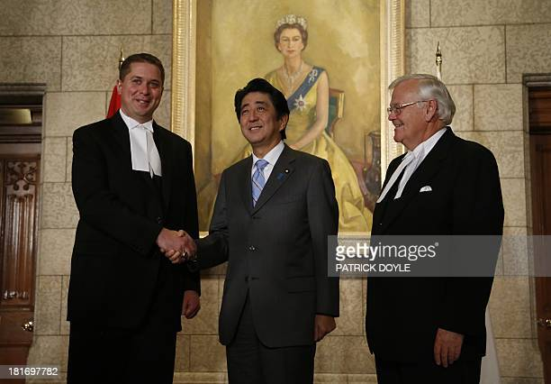 Prime Minister of Japan Shinzo Abe is greeted by Speaker of the House of Commons Andrew Scheer and Speaker of the Senate Noel Kinsella on Parliament...