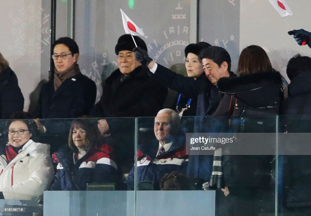 Prime Minister of Japan Shinzo Abe salutes the athletes of Japan while President of North Korea Kim Yo-jong and Kim Yo-jong, sister of President of North Korea Kim Jong-un look on during the Opening Ceremony of the PyeongChang 2018 Winter Olympic Games at PyeongChang Olympic Stadium on February 9, 2018 in Pyeongchang-gun, South Korea.