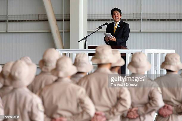 Prime Minister of Japan Shinzo Abe speaks during his visit to the Self Defense Forces stationed in Djibouti on August 27 2013 in Djibouti Abe told...