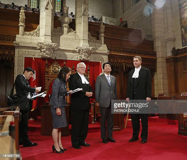 Prime Minister of Japan Shinzo Abe stands with Speaker of the House of Commons Andrew Scheer and Speaker of the Senate Noel Kinsella during a tour of...