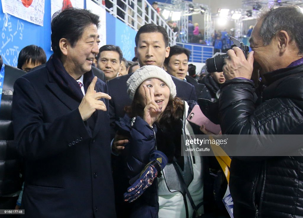 Prime Minister of Japan Shinzo Abe walks all around the stadium to greet fans during an intermission of the women's ice hockey preliminary match between Japan and Sweden during the 2018 Winter Olympic Games at Kwandong Hockey Centre on February 10, 2018 in Gangneung, Pyeongchang, South Korea.
