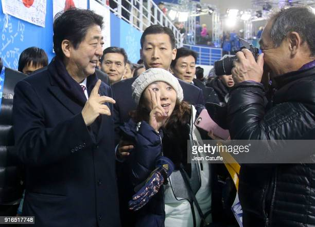 Prime Minister of Japan Shinzo Abe walks all around the stadium to greet fans during an intermission of the women's ice hockey preliminary match...