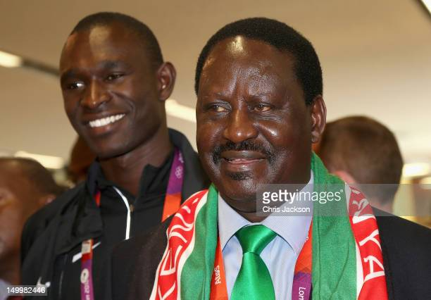 Prime Minister of Kenya Raila Odinga smiles next to athlete David Rudisha as he visits Kenya National House on August 8 2012 in London England