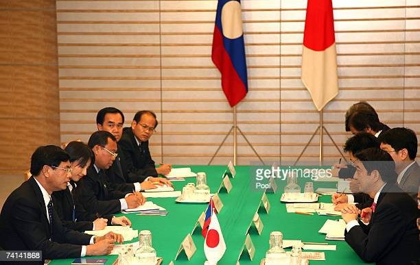 Prime Minister of Laos Bouasone Bouphavanh talks with Prime Minister of Japan Shinzo Abe during their meeting at the Prime Minister's official...