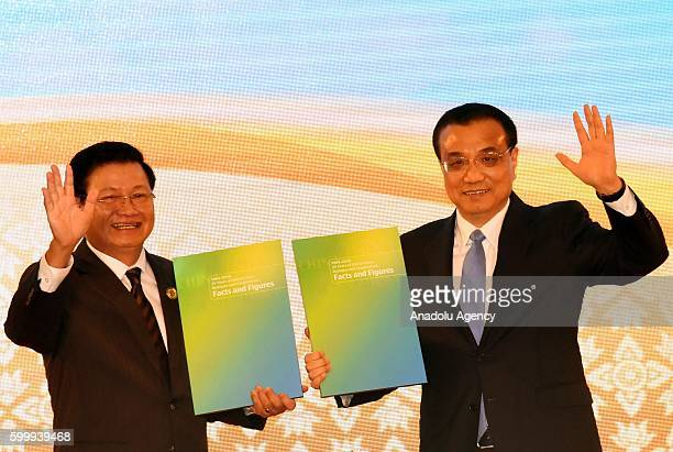 Prime Minister of Laos Thongloun Sisoulith and China's Premier Li Keqiang wave their hands as the Association of Southeast Asian Nations member...