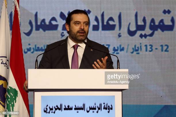 Prime Minister of Lebanon Saad Hariri delivers a speech during the financing meeting to reconstruct Syria Iraq Yemen and Libya on May 12 2017 in...