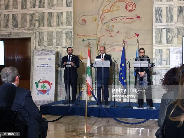 Prime Minister of Lebanon Saad Hariri Italian Foreign Minister Angelino Alfano and UN Special Coordinator for Lebanon Pernille Dahler Kardel hold a...