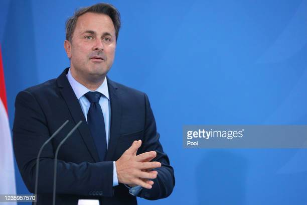 Prime Minister of Luxembourg Xavier Bettel attends a press conference with German Chancellor Angela Merkel after talks on October 18, 2021 in Berlin,...