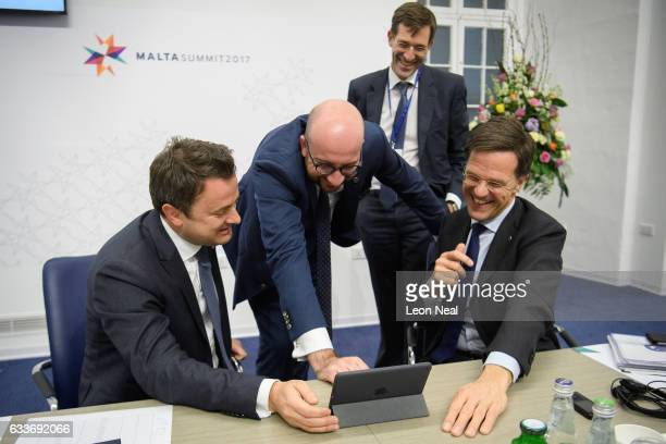 Prime Minister of Luxembourg Xavier Bettel Prime Minister of Belgium Charles Michel and Prime Minister of the Netherlands Mark Rutte laugh as they...