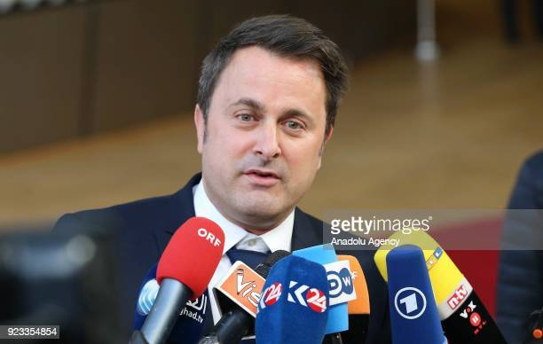 Prime Minister of Luxemburg Xavier Bettel answers the questions of press members as he arrives to attend the EU members' informal meeting of the 27...