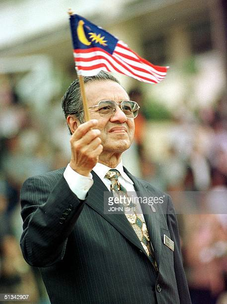 Prime Minister of Malaysia Mahathir Mohamad waves the Malaysian flag during a gathering of 2000 Malaysian Chinese during an event held at Putra Jaya...