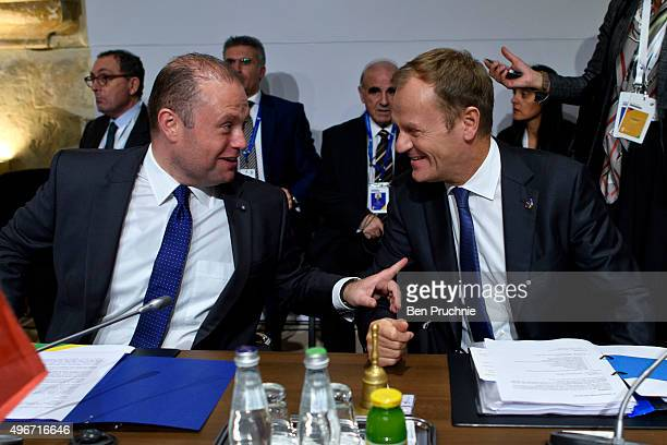 Prime Minister of Malta Joseph Muscat and President of the European Council Donald Tusk talk before first session of the Valletta Summit on migration...