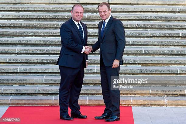 Prime Minister of Malta Joseph Muscat greets President of the European Council Donald Tusk at the Auberge de Castille ahead of the Valletta Summit on...