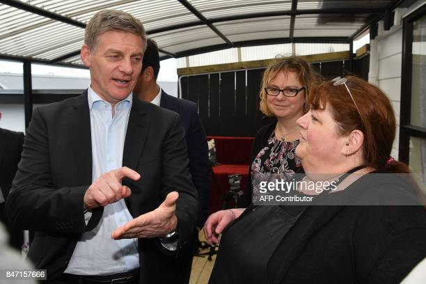 Prime Minister of New Zealand Bill English speaks with volunteers at Kitten Inn in Lower Hutt during the National party's campaign trail in...
