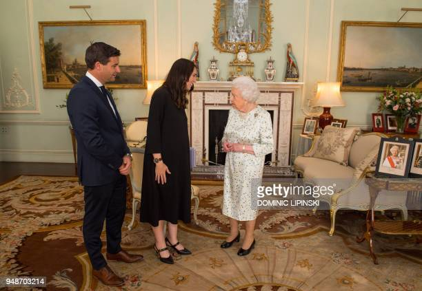 Prime Minister of New Zealand Jacinda Ardern and her partner Clarke Gayford are greeted by Britain's Queen Elizabeth II during a private audience at...