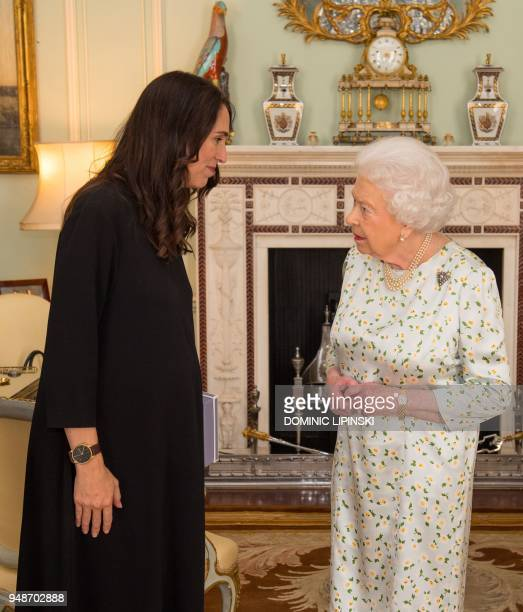Prime Minister of New Zealand Jacinda Ardern is greeted by Britain's Queen Elizabeth II during a private audience at Buckingham Palace in London on...