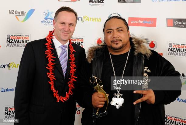 Prime Minister of New Zealand John Key and Savage pose during the 2009 Vodafone Music Awards at Vector Arena on October 8, 2009 in Auckland, New...