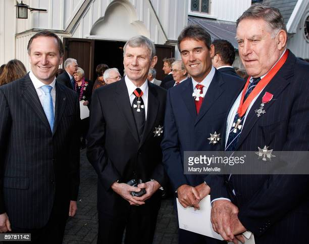 Prime Minister of New Zealand John Key joins Sir Peter Snell Sir Russell Coutts and Sir Colin Meads after an investiture ceremony for the 72 New...