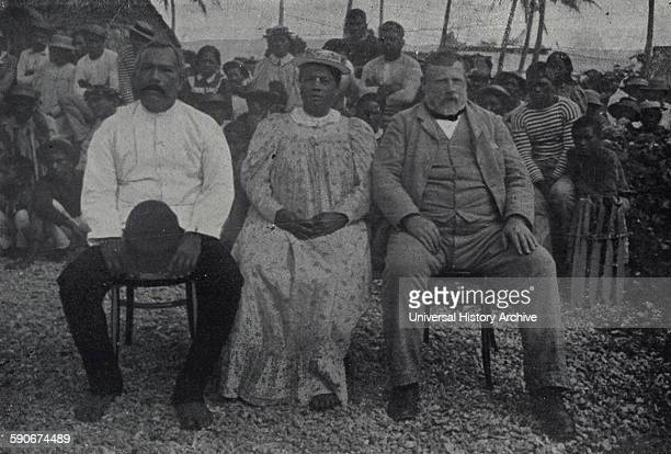 Prime Minister of New Zealand Richard Seddon and wife Mrs. Seddon with the King and Queen of Mangaia. Dated 1900.