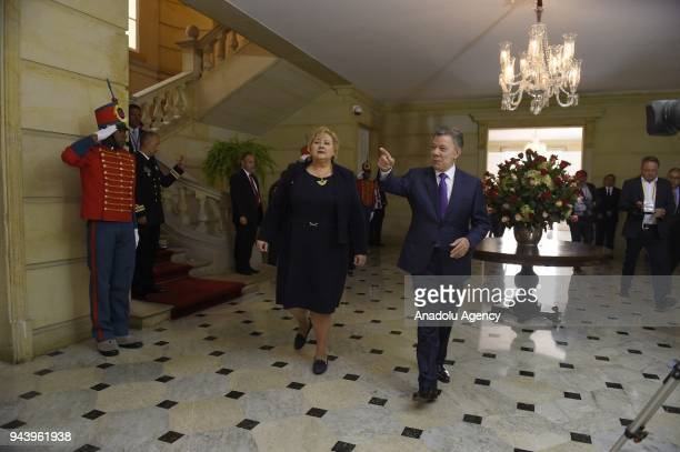 Prime Minister of Norway Erna Solberg is welcomed by Colombian President Juan Manuel Santos with an official welcoming ceremony at Casa de Narino in...