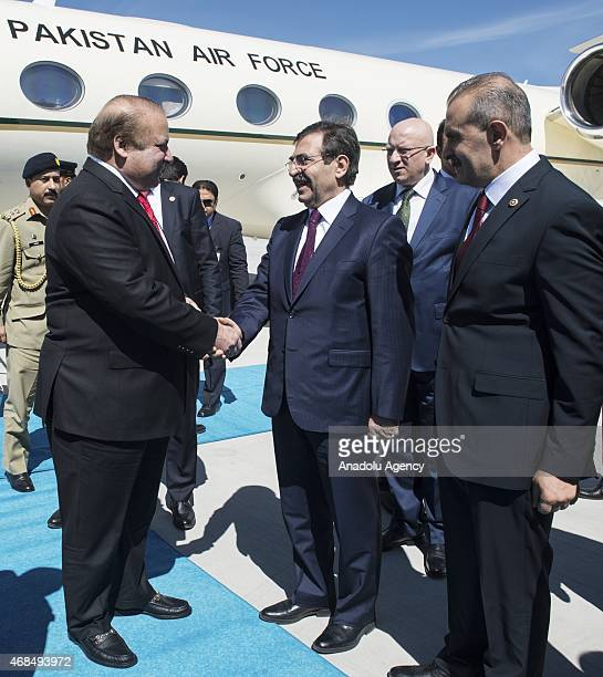 Prime Minister of Pakistan Nawaz Sharif is welcomed by Turkey's Environment and Urbanization Minister Idris Gulluce upon his arrival at Esenboga...