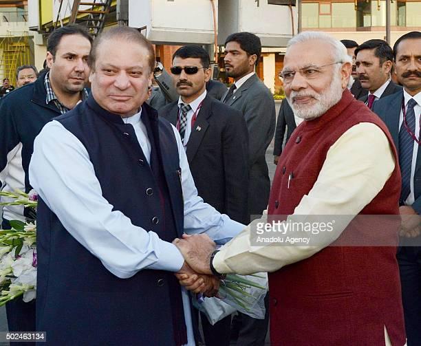 Prime Minister of Pakistan Nawaz Sharif shakes hands with Indian Prime Minister Narendra Modi in Lahore Pakistan on December 25 2015