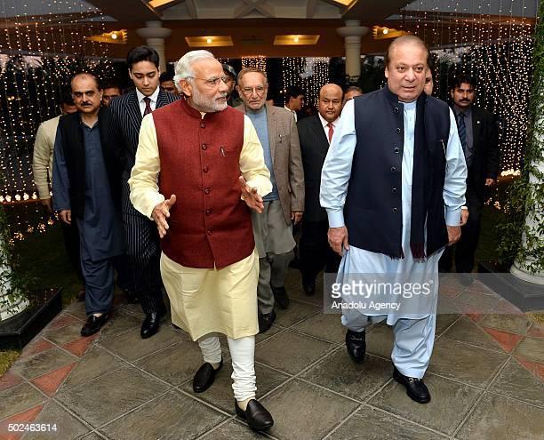 Prime Minister of Pakistan Nawaz Sharif welcomes Indian Prime Minister Narendra Modi at Allama Iqbal International Airport in Lahore Pakistan on...