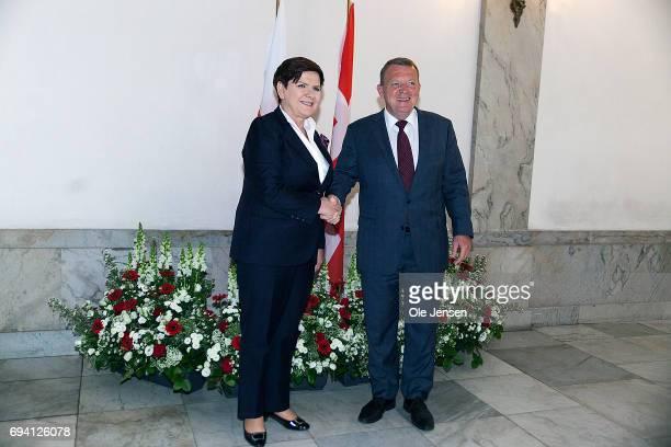 Prime Minister of Poland Beata Szydlo and Danish Prime Minister Lars Loekke Rasmussen shake hands during the Polish Prime Minister's arrival to the...