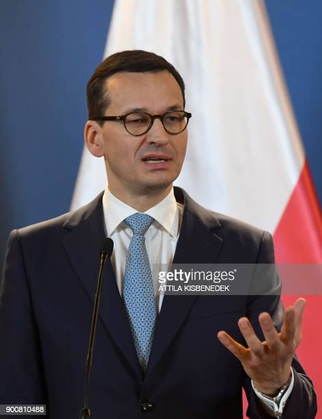 Prime Minister of Poland Mateusz Morawiecki gestures as he gives a joint press conference with the Hungarian Prime Minister at the Hungarian...