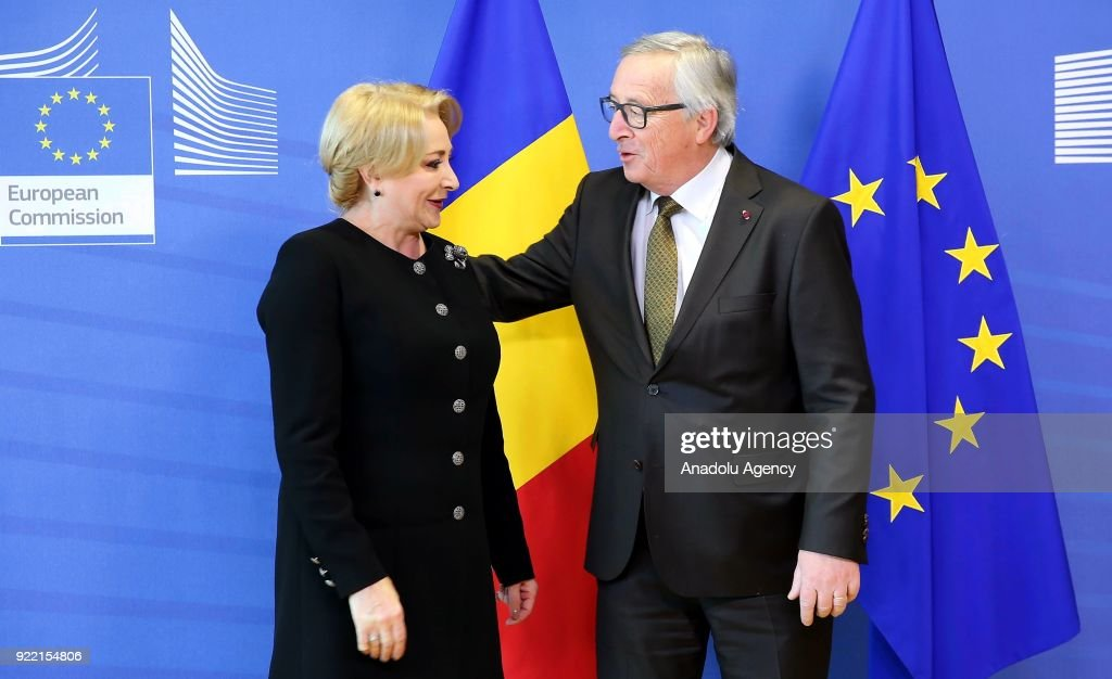 Prime Minister of Romania Viorica Dancila (L) and European Commission President Jean-Claude Juncker (R) hold a meeting in Brussels, Belgium on February 21, 2018.