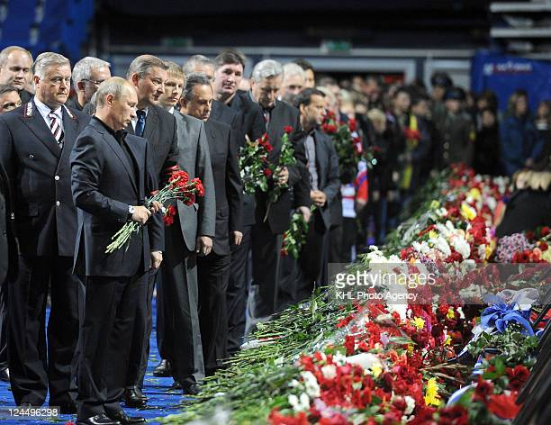 Prime Minister of Russia Vladimir Putin and president of the Russian Hockey Federation Vladislav Tretyak lay flowers for players coaches and...