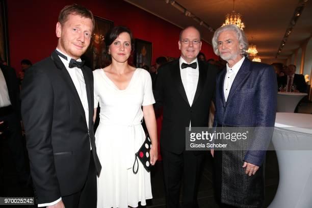 Prime Minister of Saxony Michael Kretschmer and his partner Annett Hofmann HRH Prince Albert II of Monaco and Hermann Buehlbecker CEO Lambertz during...