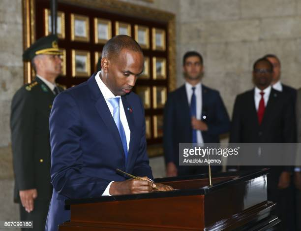 Prime Minister of Somalia Hassan Ali Khayre signs a guest book as he visits Ataturk's mausoleum Anitkabir in Ankara Turkey on October 27 2017