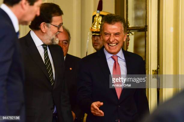Prime Minister of Spain Mariano Rajoy and President of Argentina Mauricio Macri laugh during the first day of the official visit of the president of...