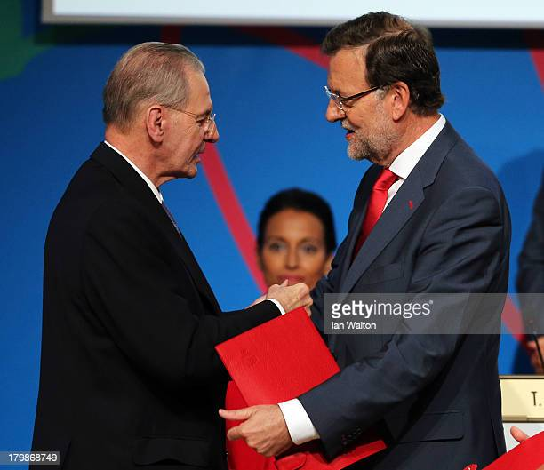 Prime Minister of Spain Mariano Rajoy shakes hands with President of the IOC Jacques Rogge during the Madrid 2020 bid presentation during the 125th...