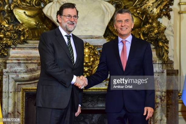 Prime Minister of Spain Mariano Rajoy shakes hands with President of Argentina Mauricio Macri during the first day of the official visit of the...