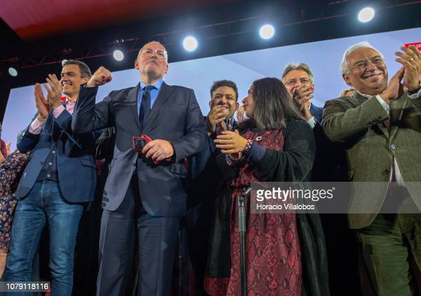 Prime Minister of Spain Pedro Sanchez and Portuguese Prime Minister Antonio Costa applaud while Frans Timmerman PES Common Candidate Designate to...