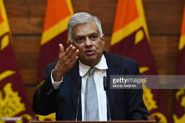 Prime Minister of Sri Lanka Ranil Wickremesinghe gestures as he answers questions from a journalist during a press conference in Colombo on April 23...