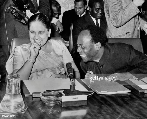 Prime Minister of Sri Lanka Sirimavo Bandaranaike laughs with President of Ghana Kwame Nkrumah during the opening session of the Commonwealth Prime...