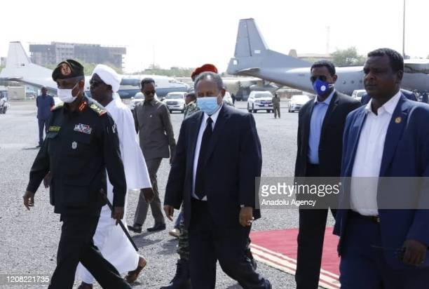 Prime Minister of Sudan, Abdalla Hamdok wears a face mask as a preventive measure against the coronavirus pandemic as he attends the official funeral...