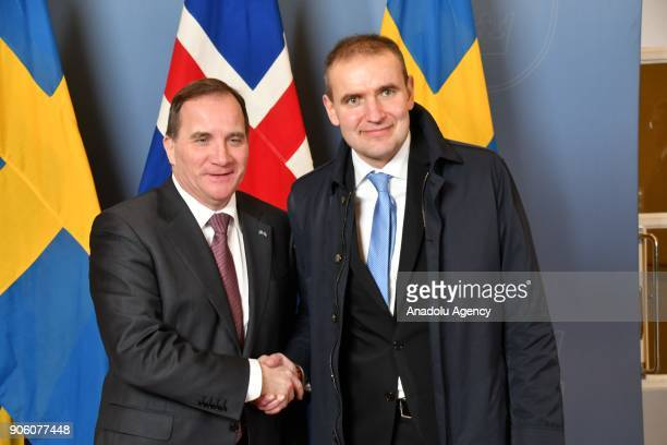Prime Minister of Sweden Stefan Lovfen and President of Iceland Guoni Th Johannesson shake hands as they pose for a photo at Prime Ministry Building...