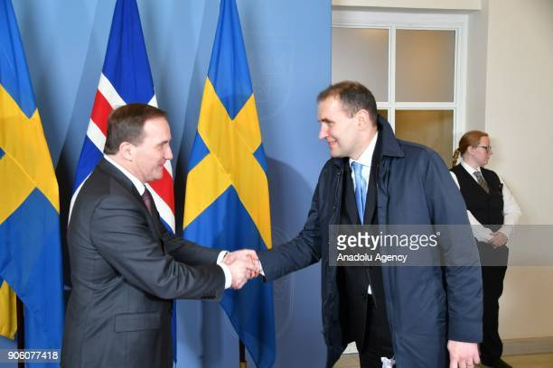 Prime Minister of Sweden Stefan Lovfen shakes hands with President of Iceland Guoni Th Johannesson at Prime Ministry Building in Stockholm Sweden on...